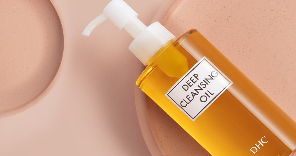 DHC's Deep Cleansing Oil on peach background